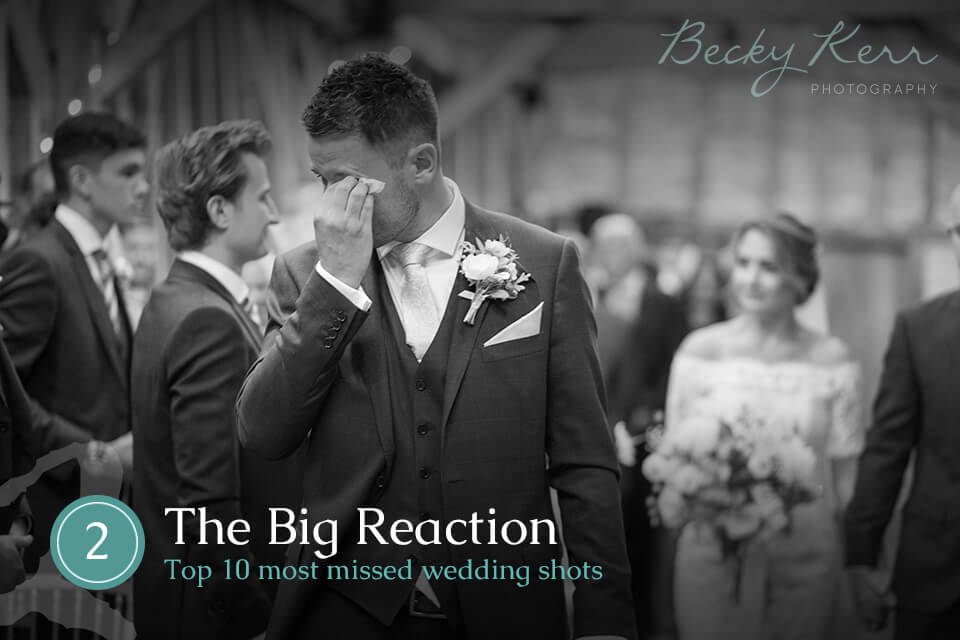 A tearful groom's reaction to seeing the bride for the first time