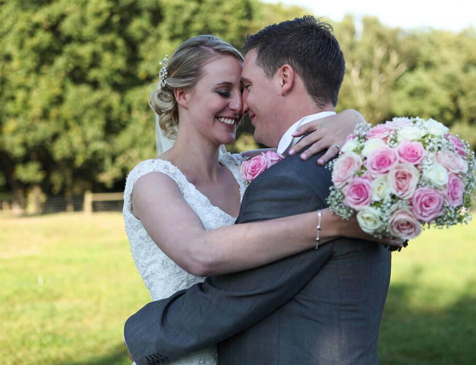 Husband and Wife embrace in the Safari Lodge gardens