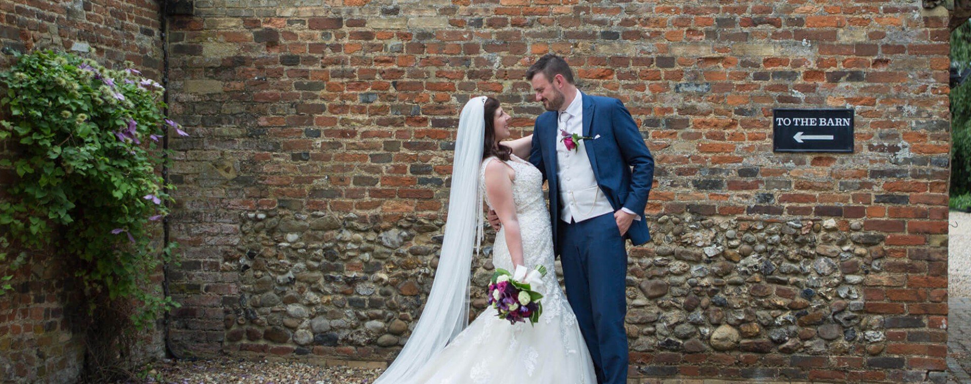 Husband and Wife pictured outside The Priory, Little Wymondley