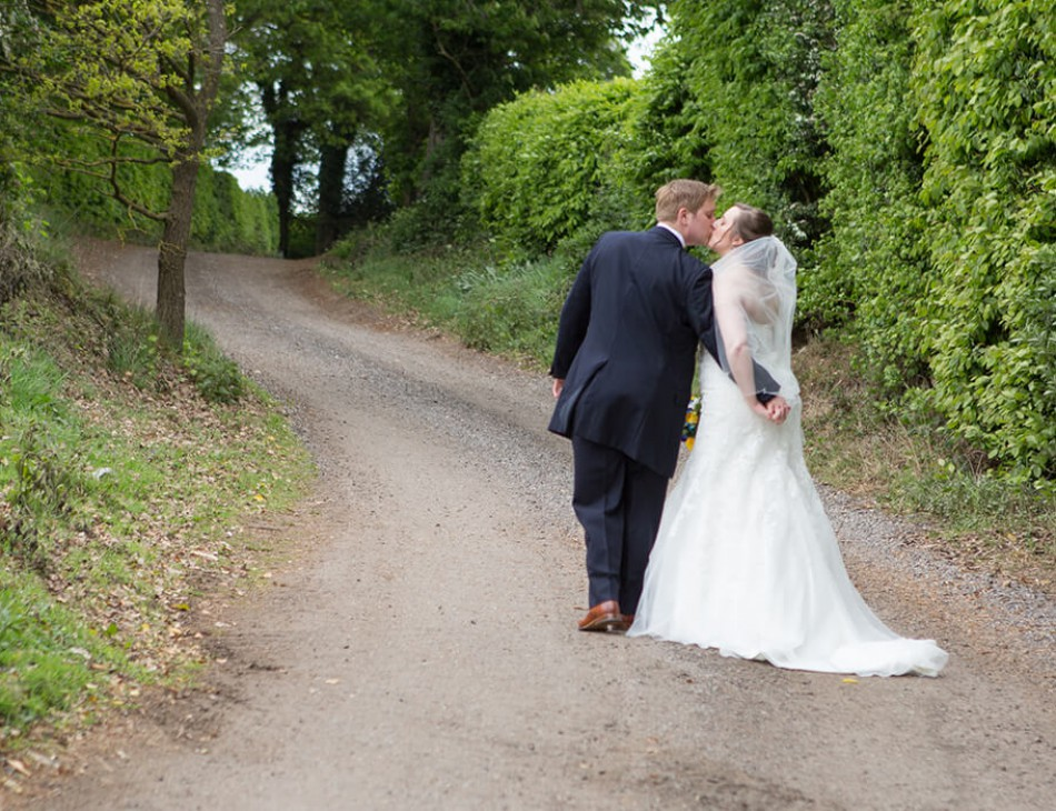 Husband and Wife walking up a path at Tewin Bury Farm Hotel
