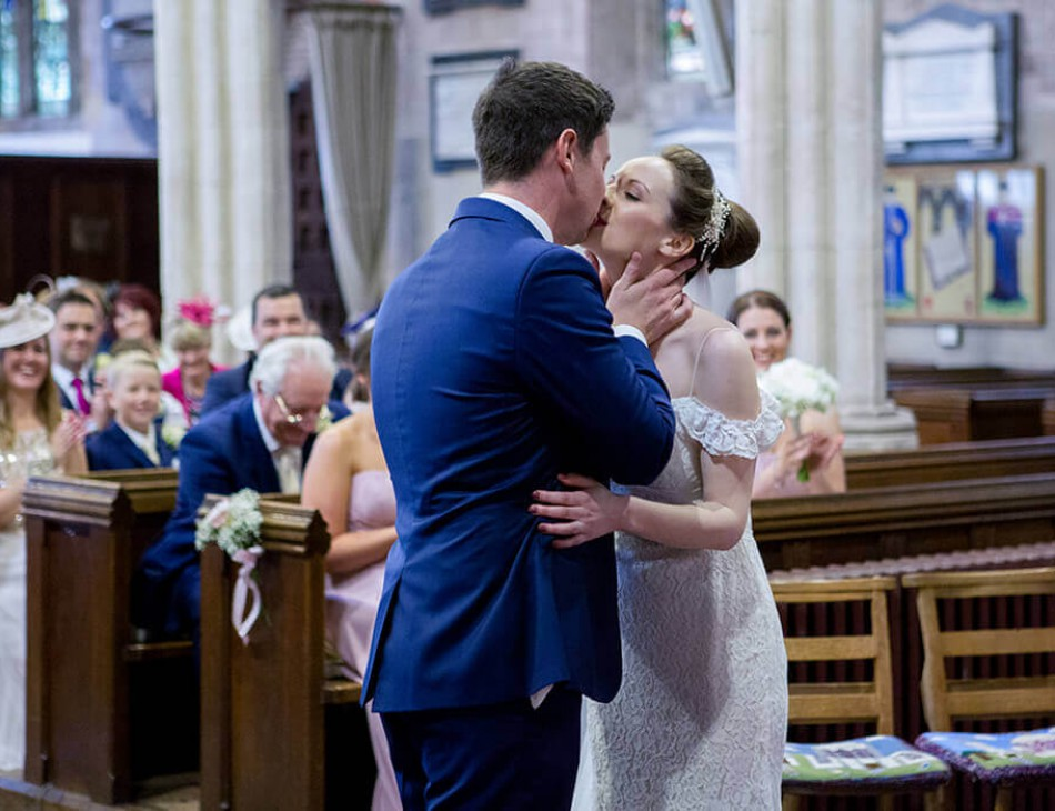 Newlyweds kiss in Berkeley Castle, Gloucestershire