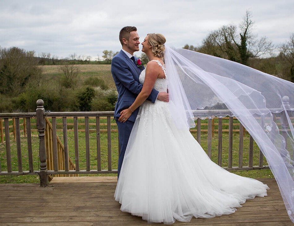 Husband and Wife embracing outside the Thatch Barn, Cambridgeshire