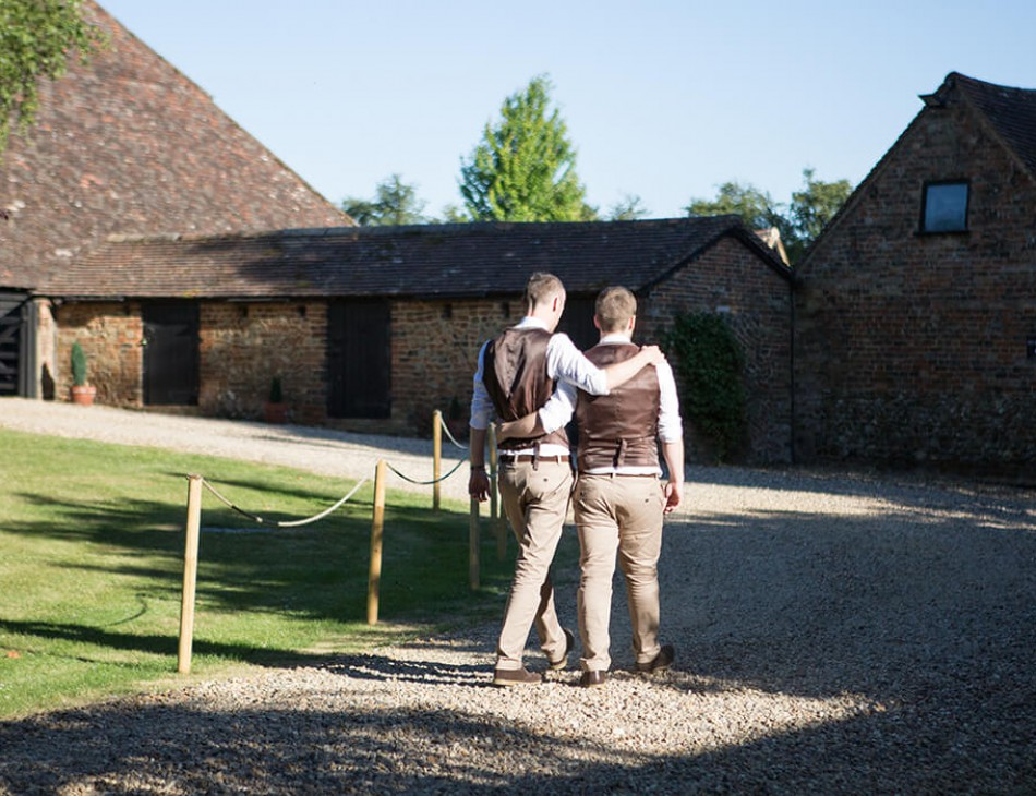 Husband and Husband walking down by The Priory Barns