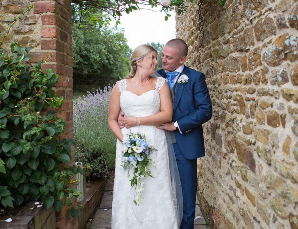Husband and Wife embrace outside Dodford Manor, Northamptonshire