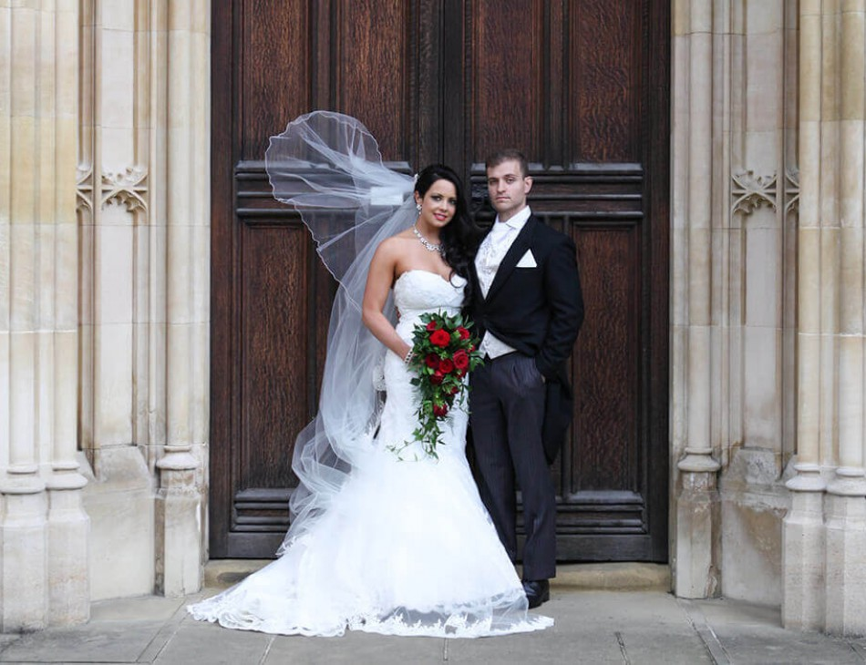 Husband and Wife stood in front of the Corpus Christi Wedding Venue