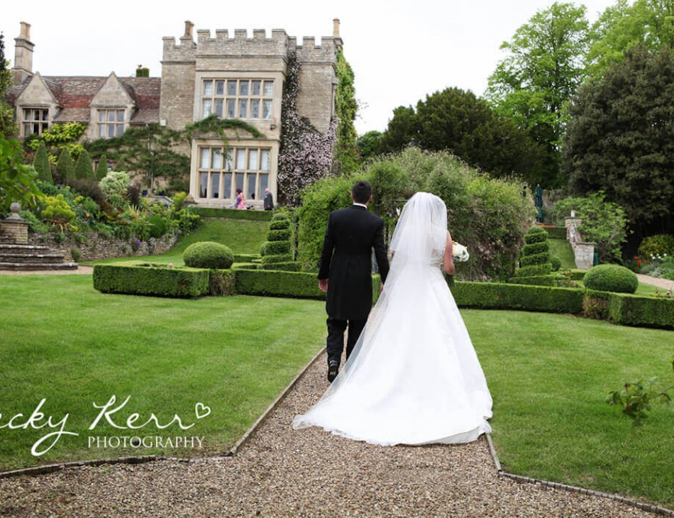 Husband and Wife walking in Tofte Manor gardens