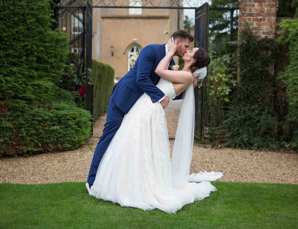 Newlyweds kiss in front of Offley Place
